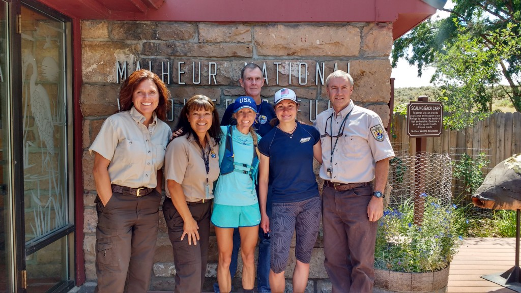 From left to right: Carey Goss, Wildlife Refuge Specialist; Suzanne McConnell, Administrative Assistant; Eddie Clark, Refuge Volunteer; Jeff Mackay, Deputy Manager. Along with Bridget (2012 Olympian) and Ladia (World Mt. Running Team)
